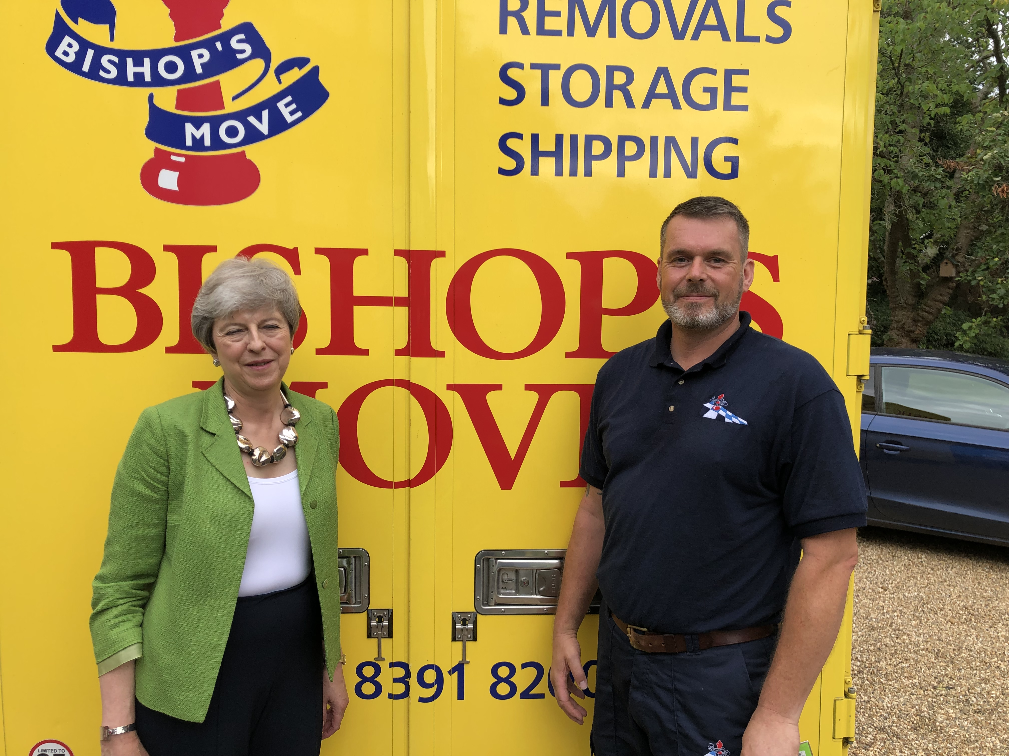Bishop's foreman Mark Allen with Theresa May