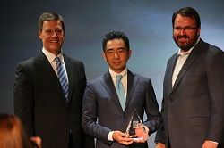 Taro Tominaga accepts the Hall of Honor award on behalf of his father Koji